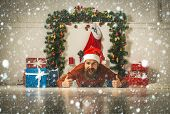 Christmas Man With Beard On Serious Face At Present Box. poster