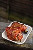 pork shank  glazed with honey  and garlic, roasted in enameled dish