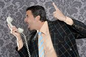 businessman shouting angry expression talking by  telephone with retro mustache