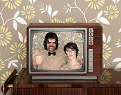 old wooden tv with nerd silly couple retro in screen on wallpaper background