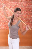 young woman doing fitness with a stick