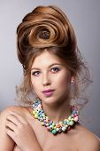 Portrait Of A Beauty Girl With Colorful Make-up, Hair, Accessories. Colorful Studio Shot Of A Stylis poster