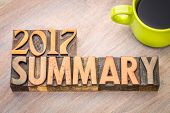 2017 summary word abstract in vintage letterpress wood type with a cup of coffee poster