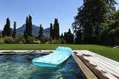 airbed floating in the pool, summer day