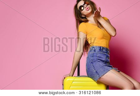 poster of Traveler Tourist Woman In Summer Casual Clothes With Travel Suitcase Send A Kiss  Isolated On Pink B