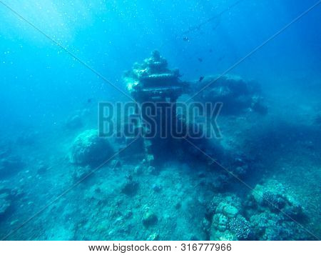 poster of Underwater ruins of ancient temple building. Rays of light under water. Ocean discovery. Under water sea treasure. Sunken statue. Lost city of atlantis.
