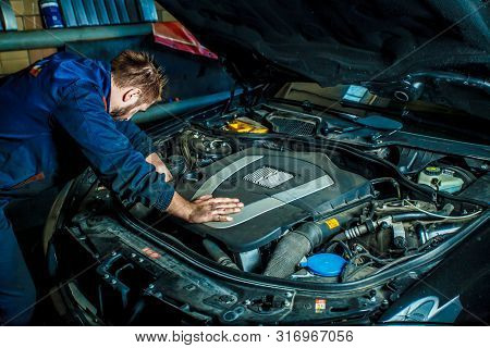 poster of Close Up Hands Of Unrecognizable Mechanic Doing Car Service And Maintenance. Mechanic Working In Car