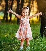Outdoor Portrait Of Adorable Smiling Little Girl In Summer Day. poster