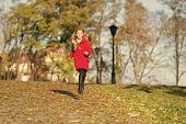 Fall Clothes And Fashion Concept. Child Blonde Long Hair Walking Fall Park Background. Feel Cozy In  poster