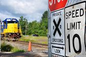 Diesel Locomotive At A Railroad Crossing In Town Of Potsdam, New York State, Usa. poster