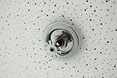 picture of retarded  - Close up image of fire sprinkler on white ceiling - JPG
