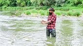 On The Fly Fishing Hobby And Sport Activity. Bearded Fisher In Water. Summer Weekend. Happy Fly Fish poster