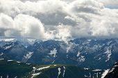 Mountains Landscape. Mountain Range Panorama With Cloudy Sky. Cheget-chat Range And Chigordali Range poster
