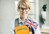 Happy Student In Glasses With English Textbooks And British Flag poster