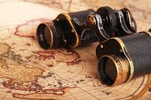 Old Binoculars On Antique Map