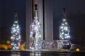 Bokeh Light From A Lamp In A Glass Bottle For Christmas, Wedding And Party Decorations. White Cold C poster