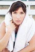 Tired Female Athlete With Towel