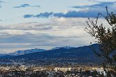 Hilltop View Of Burbank And San Fernando Valley, San Gabriel Mountains With Cloudscape poster