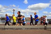 Runners In The Sunshine Along The River