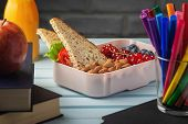 Healthy Food For School Lunch. On The Table Among The Textbooks Is A School Lunch, In A Box Are Almo poster