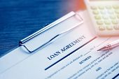Loan Agreement Application Form With Pen And Calculator On Paper Financial Help / Financial Loan Neg poster