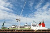 The Industrial View Of A Crane And Ships On A Dry Dock On Grand Bahama Island (bahamas). poster