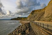 The Sandstone Cliffs At West Bay In Dorset, England. This Is Part Of The Jurassic Coast Which Runs F poster