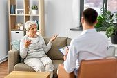 geriatric psychology, mental therapy and old age concept - senior woman patient and psychologist at  poster