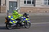 pic of bobbies  - British motorcycle policeman in full florescent uniform - JPG