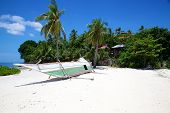 Banca Boat On White Sand Tropical Beach On Malapascua Island, Philippines