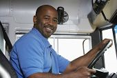 Portrait of an African American handsome bus driver smiling