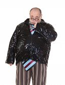 stock photo of outrageous  - Fun portrait of an obese man with an outrageous fashion sense wearing a mixture of stripes checks and spangles topped by an oversized flamboyant tie on white - JPG