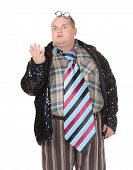 foto of outrageous  - Fun portrait of an obese man with an outrageous fashion sense wearing a mixture of stripes checks and spangles topped by an oversized flamboyant tie on white - JPG