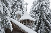 Wooden Chapel In A Snowy Forest. Winter North.