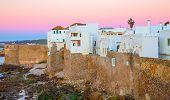 stock photo of asilah  - Sunset with pink colors in Asilah and atlantic ocean in Morocco - JPG
