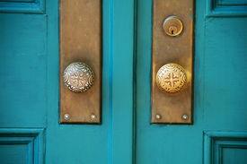 pic of door-handle  - old double wooden doors with brass hardware - JPG