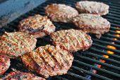 Hamburger patties on a grill