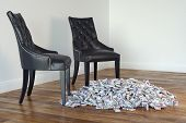Two Black Chairs In Minimalist Interior With Stack Of Money On Laminate