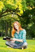 A Woman Doing Bible Study In A Park