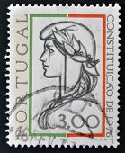 A stamp printed in Portugal shows allegory of of democracy the 1976 Constitution