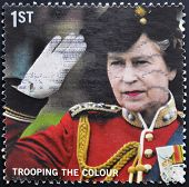 A stamp shows Queen taking the salute as Colonel-in-Chief of the Genedier Guards