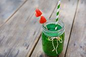 stock photo of mint-green  - Spinach green smoothie as healthy summer drink - JPG