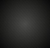 Carbon fiber background texture. Vector seamless pattern industrial material design