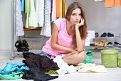 image of boutique  - Beautiful girl thinking what to dress in walk - JPG