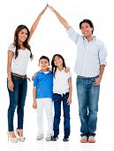 Happy family in a safe home - isolated over white background