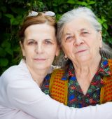 Family - Middle Age Daughter And Senior Mother
