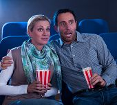 Couple Watching A Movie Reacting In Horror