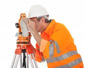 picture of theodolite  - Portrait of Senior land surveyor working with theodolite - JPG