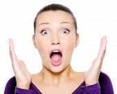 Portrait of young screaming woman with hands up - isolated