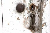 Doorknob And Bunch Of Keys In Peeling Shed Door